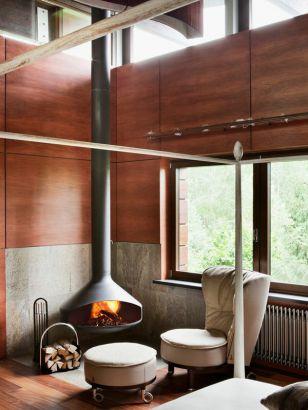 Cheminée Design Ergofocus située dans un coin du salon